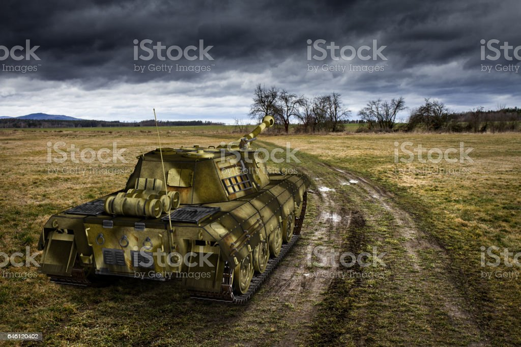 Army tank on the muddy field stock photo