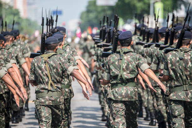 Army troops marching and parading Rio de Janeiro, Brazil. 07th September 2016. Army troopers lined up marching together parading in full military uniform, holding weapons during Brazilian Independence day parade, Downtown Rio de Janeiro. military parade stock pictures, royalty-free photos & images
