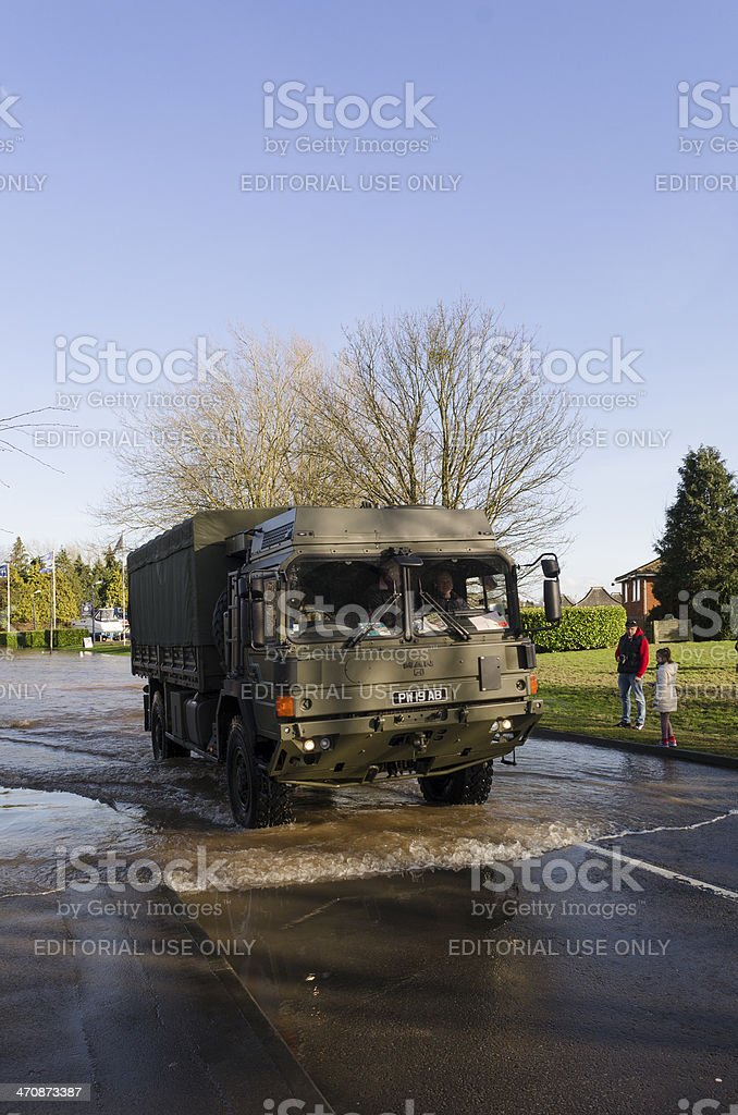 Army truck helping flood victims royalty-free stock photo