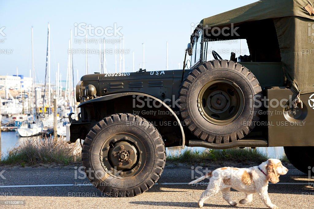 Army trucks of organization Kelly's Heroes riding on beach royalty-free stock photo