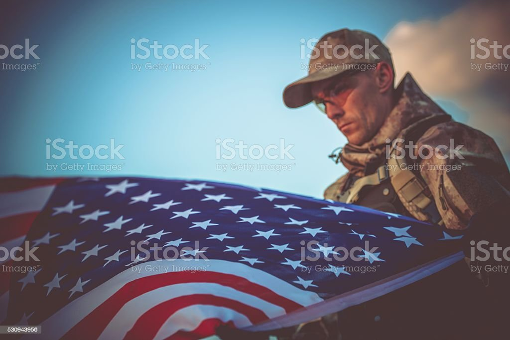 Army Veteran with USA Flag stock photo