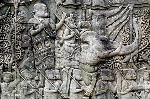 1147569123 istock photo Army with Khmer soldiers and elephants on the 12th century relief of Bayon temple, Cambodia. Historical artwork on wall of the landmark in Angkor. UNESCO world heritage site 1215316865