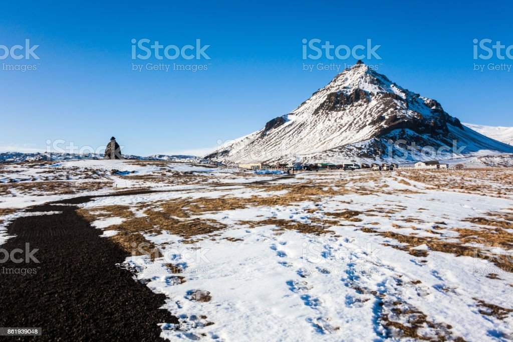 Arnarstapi or Stapi is a small fishing village at the foot of Mountain Stapafell between Hellnar village and Breidavik farms stock photo