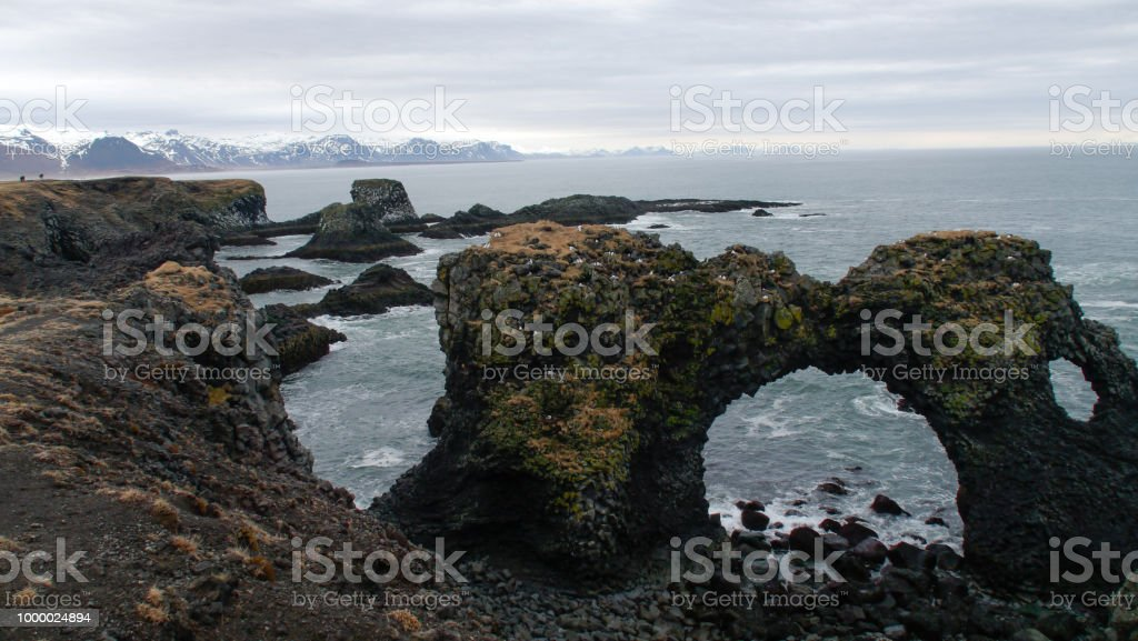 Arnarstapi rock and bech stock photo