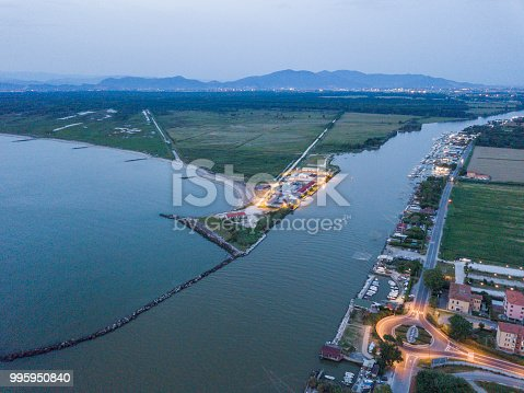 Arno River flows into the sea. Pisa Marina. Italy. Aerial view landscape