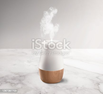 White & wood textured aroma diffuser and humidifier on a background
