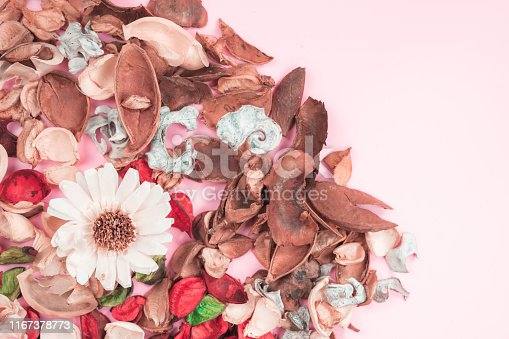 istock aroma therapy and spa object in spring season by minimal flat lay style with dry tropical leaf decorate on pink vintage background 1167378773