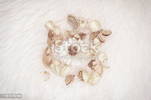 istock aroma therapy and spa object in spring season with dry tropical leaf decorate on white wool or fur background 1167378739