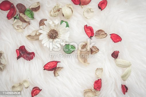 istock aroma therapy and spa object in spring season with red and green dry tropical leaf decorate on white wool or fur background 1143934808