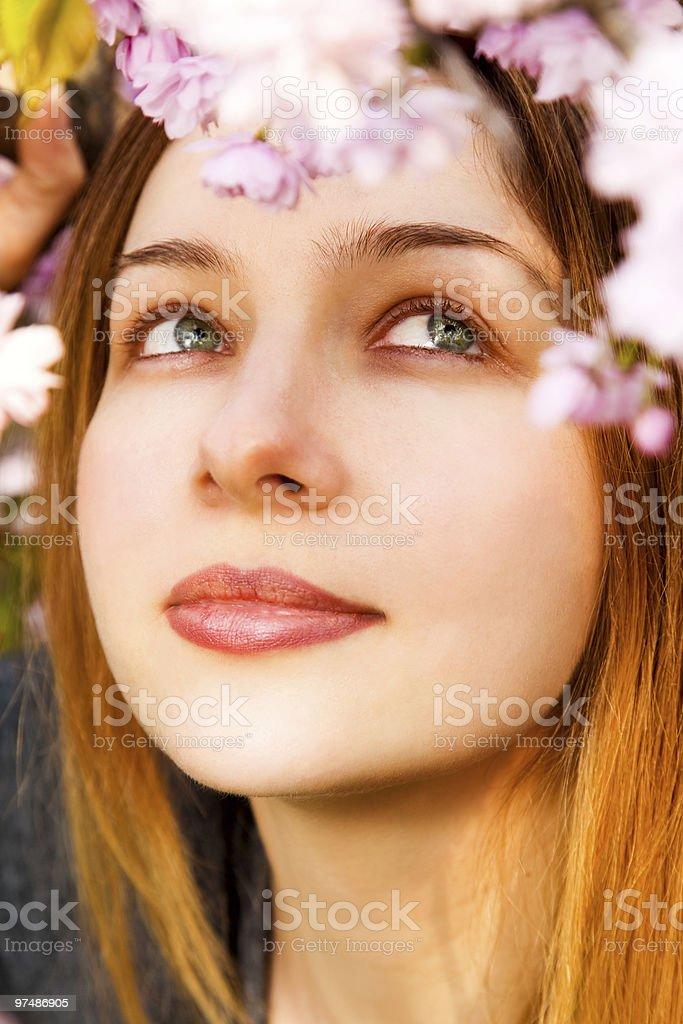 Aromatherapy - beautiful woman smelling flowers royalty-free stock photo