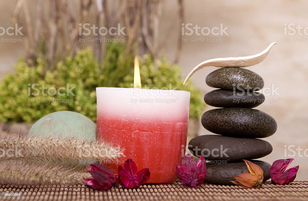 Aromatherapy candle and balanced stones royalty-free stock photo