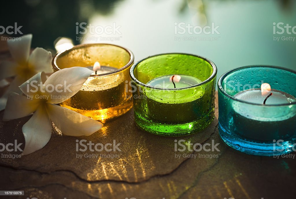 Aromatherapy candle and flowers stock photo