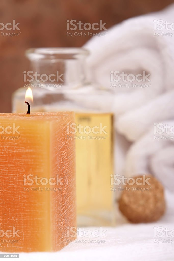 Aromatherapy candle and massage oils royalty-free stock photo