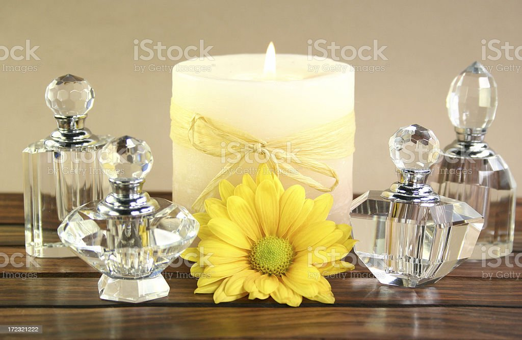 aromatherapy candle & crystal bottles with flower royalty-free stock photo