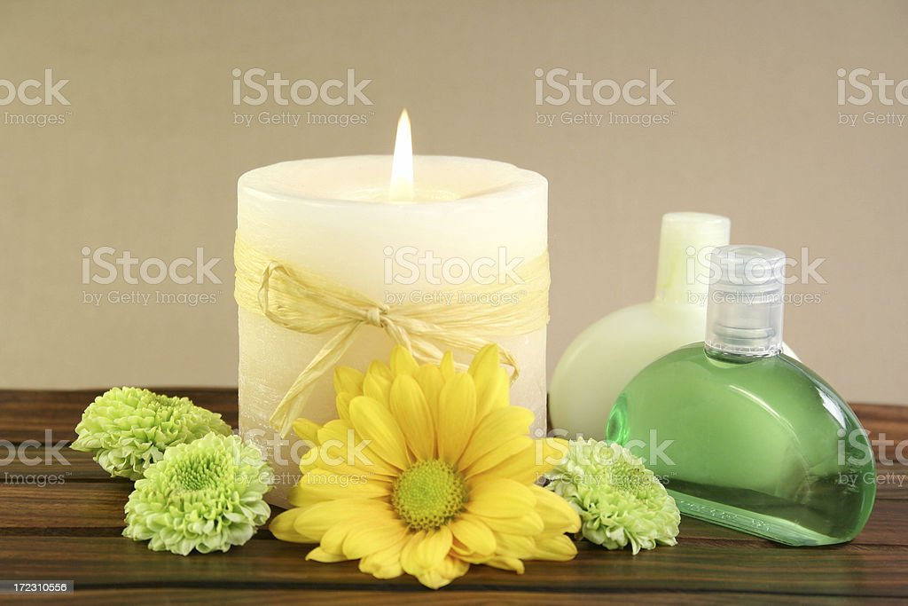 aromatherapy candle, oils & flowers royalty-free stock photo