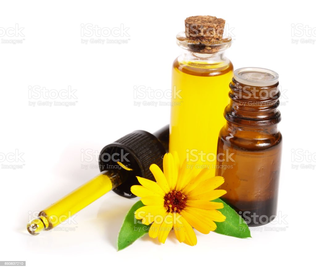 aromatherapy essential oil with marigold flowers isolated white background stock photo