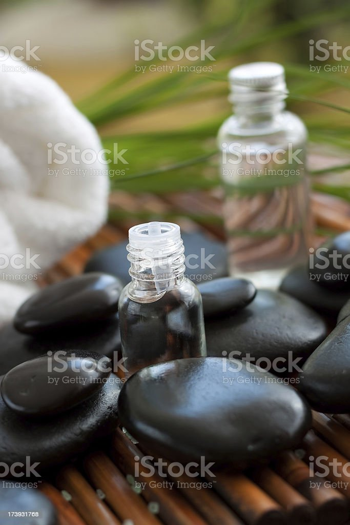 Aromatherapy oil and massage stones royalty-free stock photo