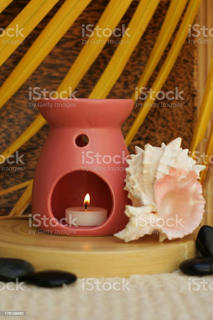 Aromatherapy oil burner and conch shell royalty-free stock photo