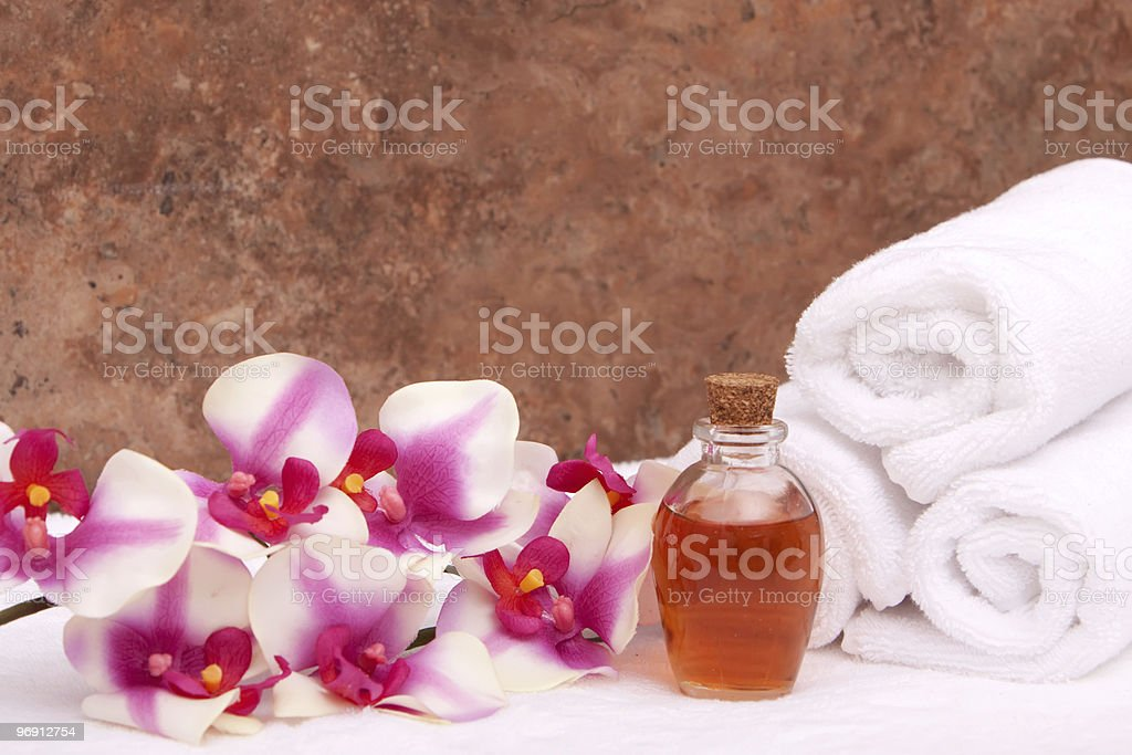 Aromatherapy oils, orchid and towels royalty-free stock photo