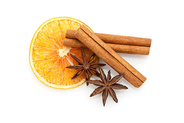 "Aromatherapy ""Dried Orange Slice, Cinnamon Sticks and Star Anise Isolated on White Background. High Angle View"" star anise on white stock pictures, royalty-free photos & images"