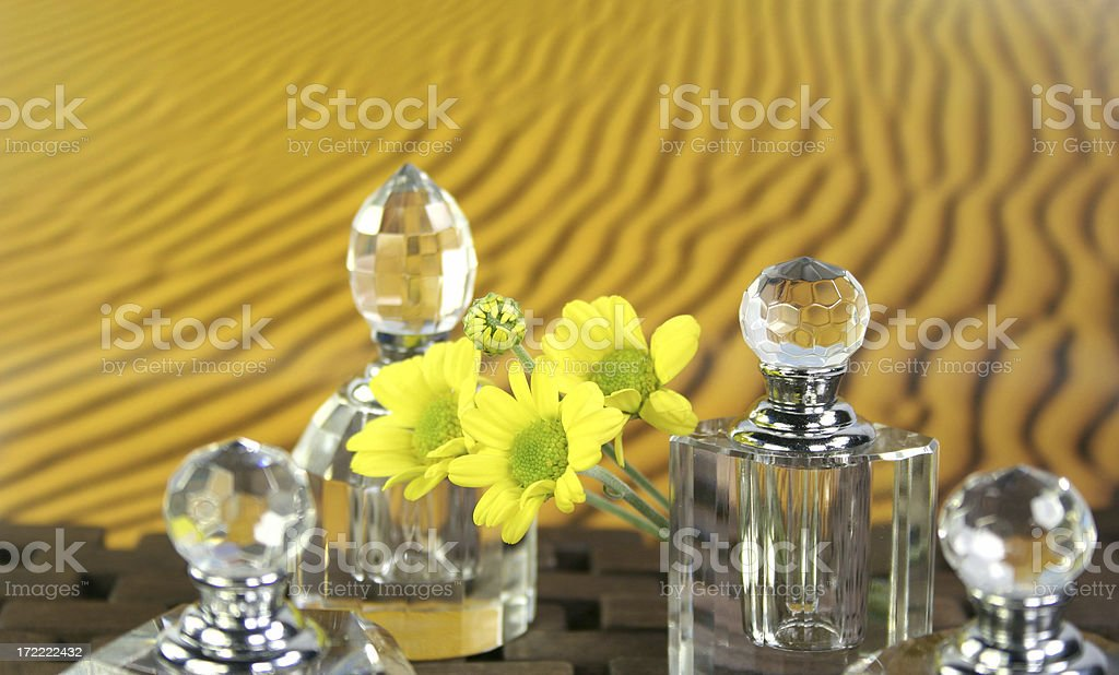 aromatherapy setting with crystal bottles desert sand background royalty-free stock photo