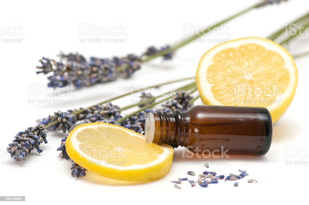 Aromatherapy with a slice of lemon and a bottle of oil stock photo