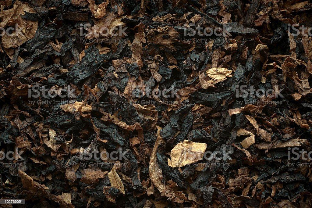 Aromatic pipe tobacco background. stock photo