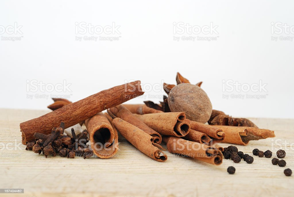Aromatic Spices on a Wooden Cutting Board with a White Background stock photo
