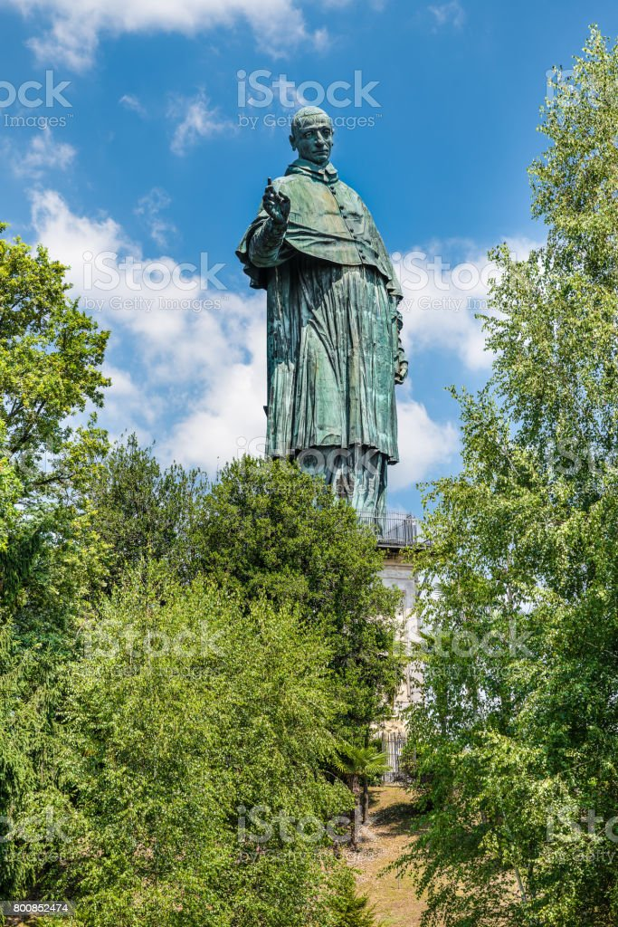Arona, lake Maggiore, Italy. Sancarlone or Colossus of San Carlo Borromeo (17th century) is a bronze statue, one of the tallest statues in the world stock photo