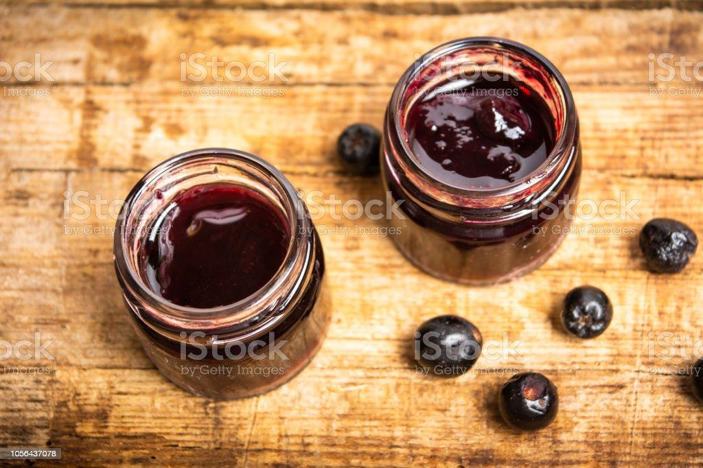 Aronia jam in a jar top view – zdjęcie