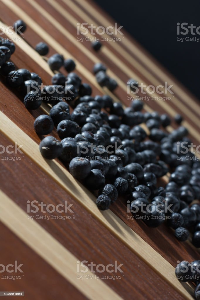 Aronia spilled on wooden table stock photo
