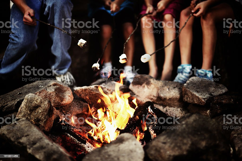 Around the campfire royalty-free stock photo