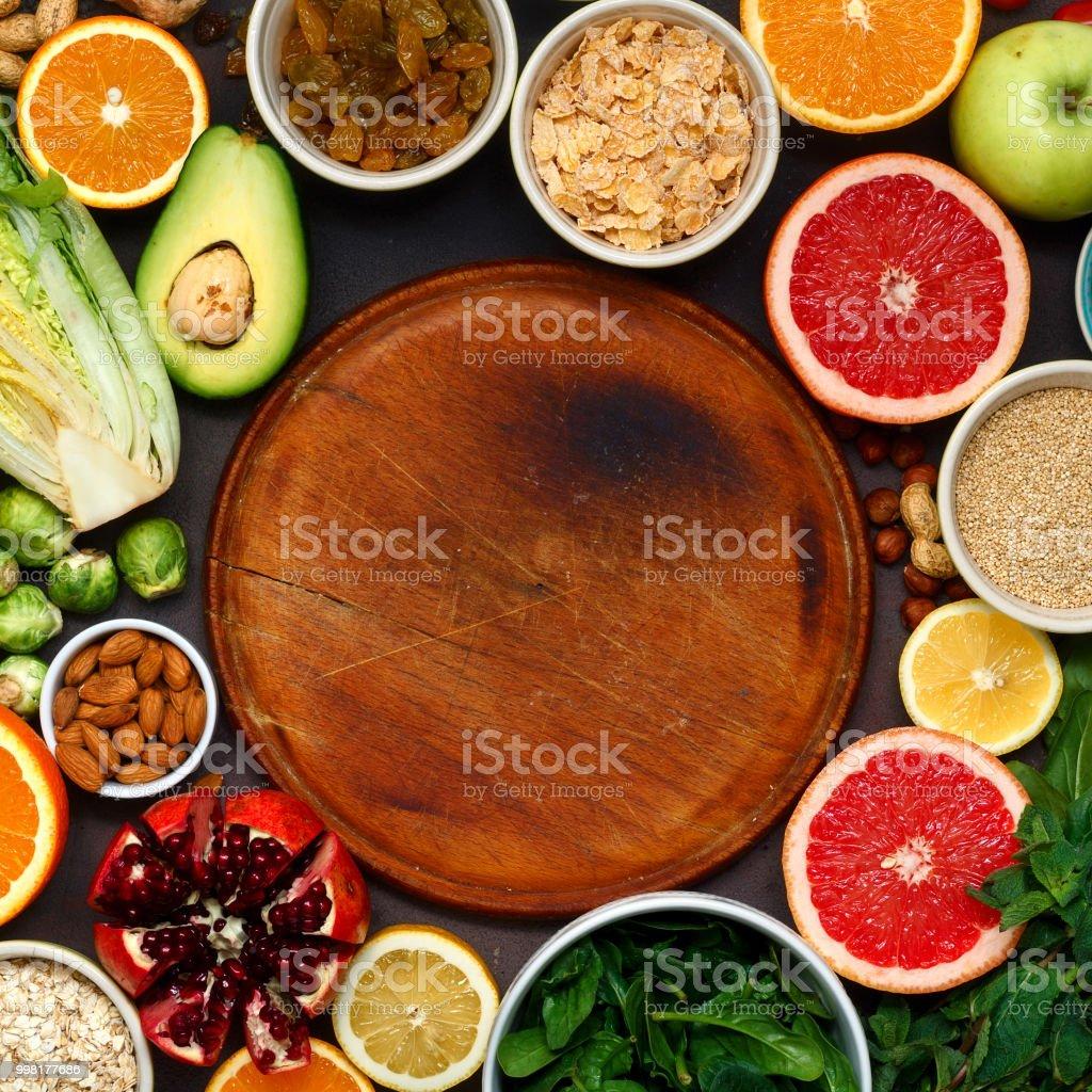 Around wooden kitchen board set clean eating Vegetarian healthy food stock photo