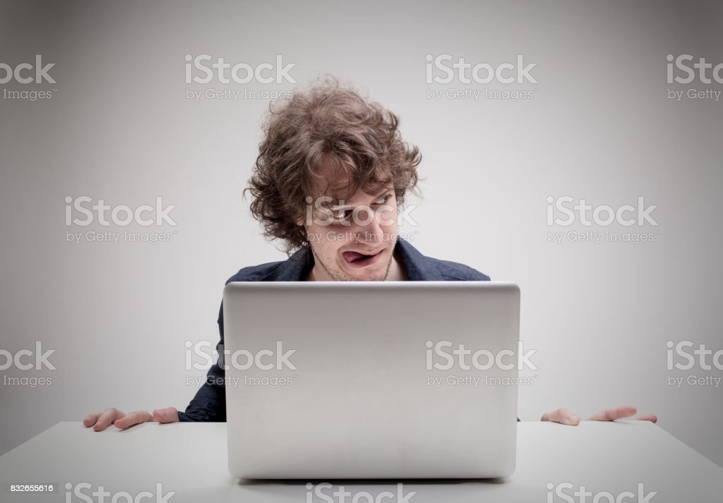 Aroused Man With Tongue Stuck Out Watching Porn Stock Photo