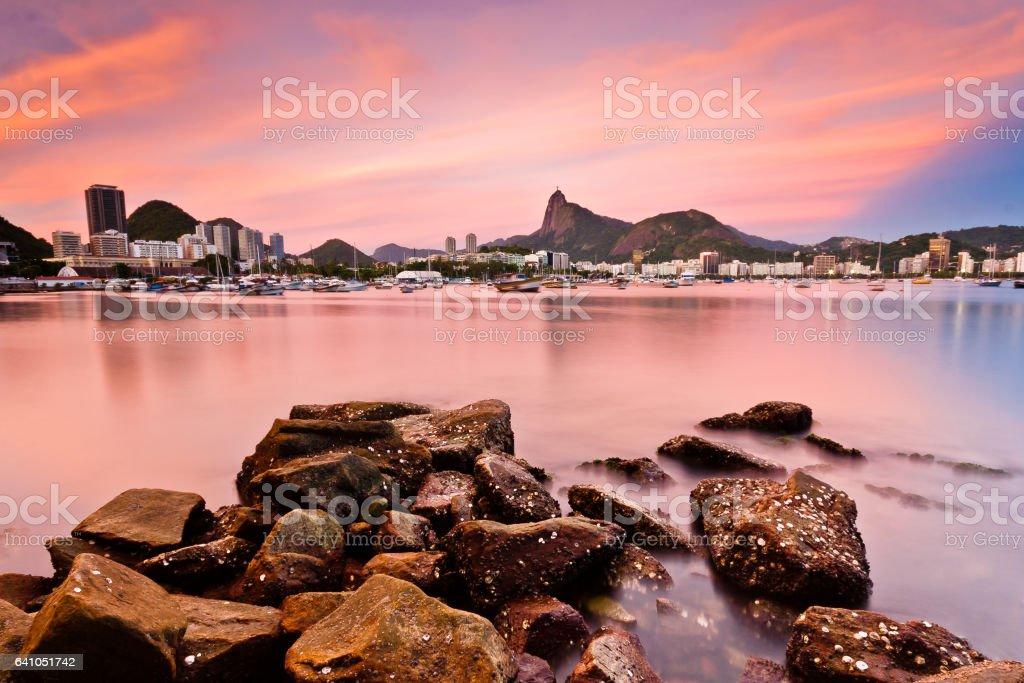 Arpoador Beach rocks reachs the ocean stock photo