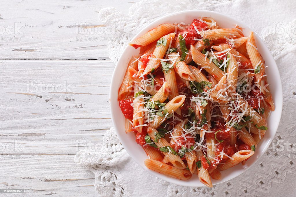 Arrabiata pasta penne with Parmesan cheese. Horizontal top view stock photo