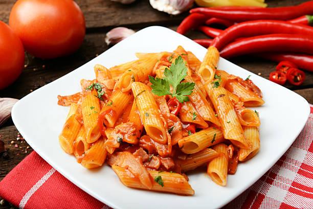 arrabiata pasta Penne pasta with chili sauce arrabiata macaroni stock pictures, royalty-free photos & images