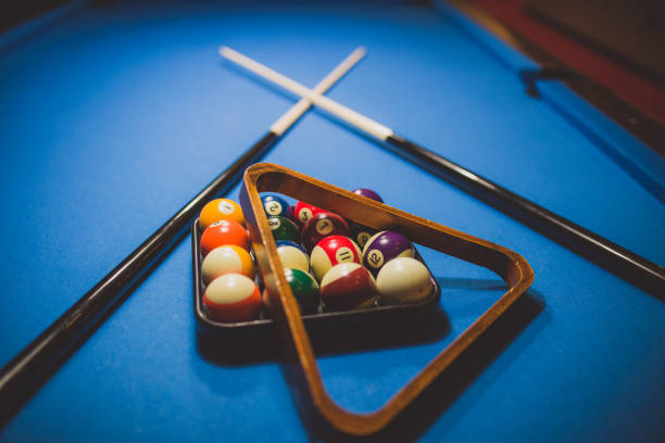 arranged billiard balls - pool cue stock photos and pictures