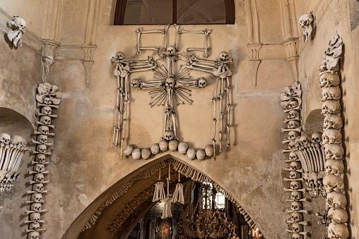 istock Arranged Human Skulls and Bones in Kostnice Church in Kutna Hora, Czech Republic. 1198263263