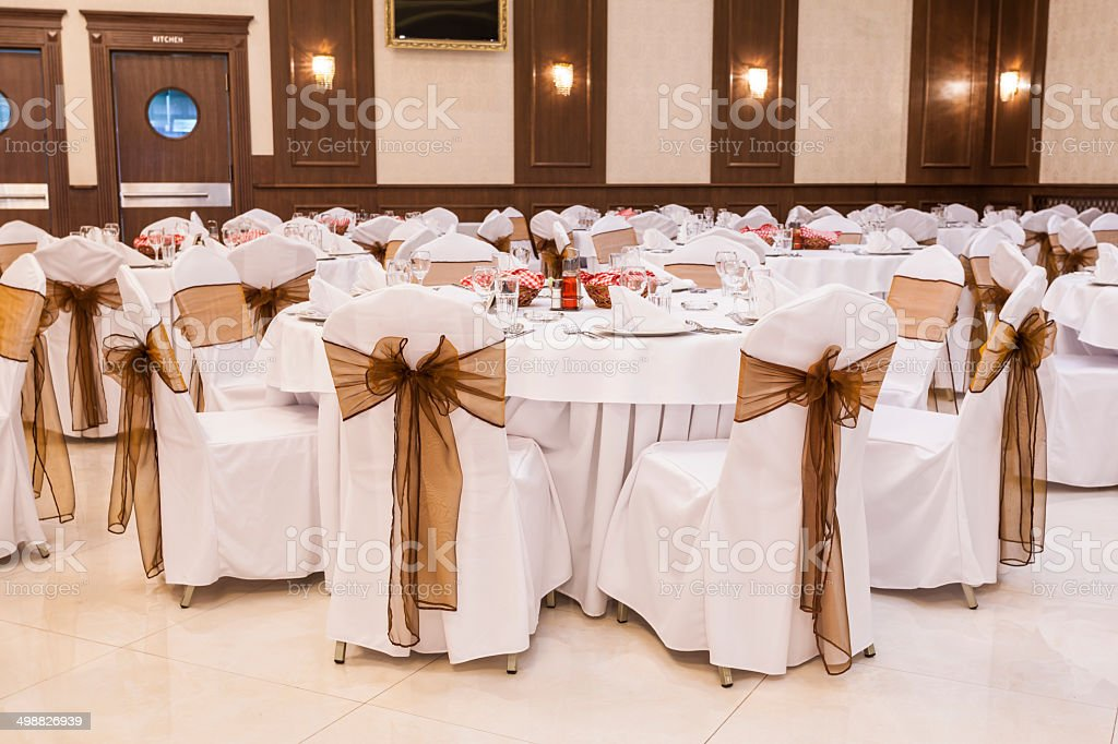 Arranged tables at banquet hall stock photo
