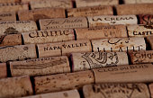 An assortment of wine corks from various wineries, mostly in California.