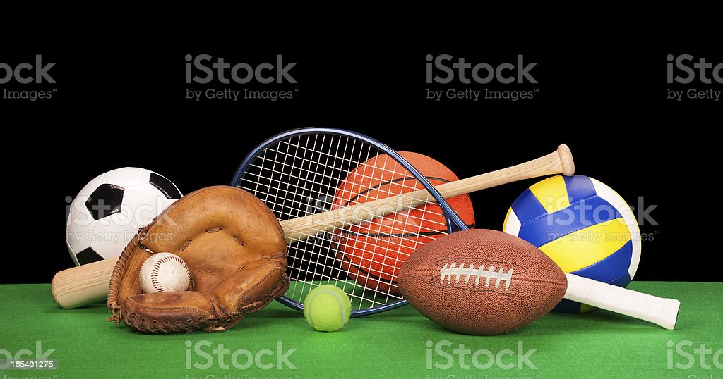 Arrangement of assorted sports equipment on black background stock photo
