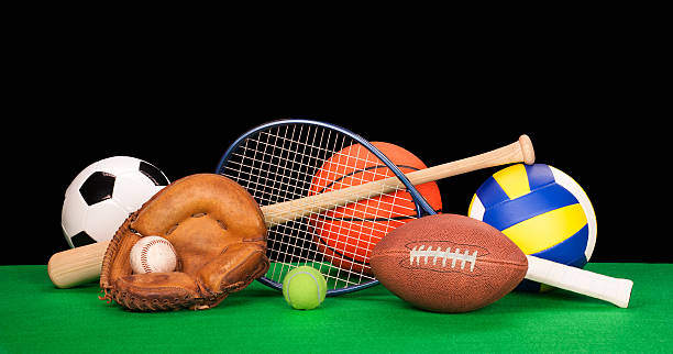 Arrangement of assorted sports equipment on black background stock photo