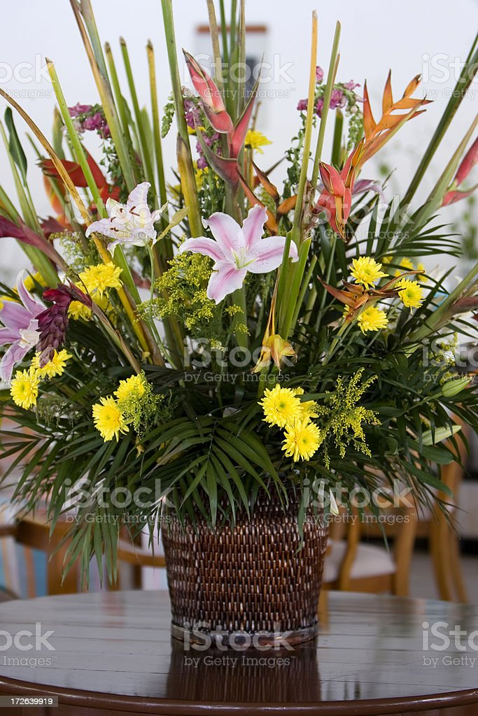 Arrangement of Beautiful Tropical Flowers in Restaurant, Copy Space royalty-free stock photo