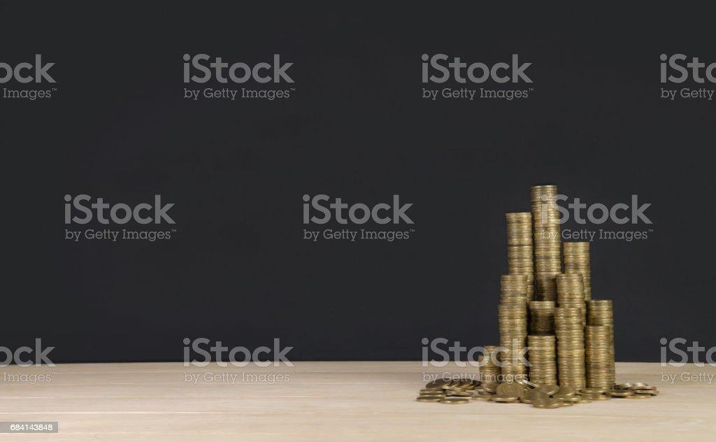arrangement of coins on grey background royaltyfri bildbanksbilder