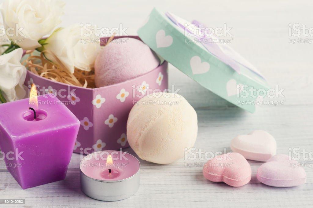 Arrangement of eustoma flowers in pot, pastel gift box stock photo