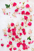 istock Arrangement of flowers. Background roses scattered on a vintage surface 1201445348