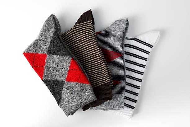 arrangement of folded socks stock photo