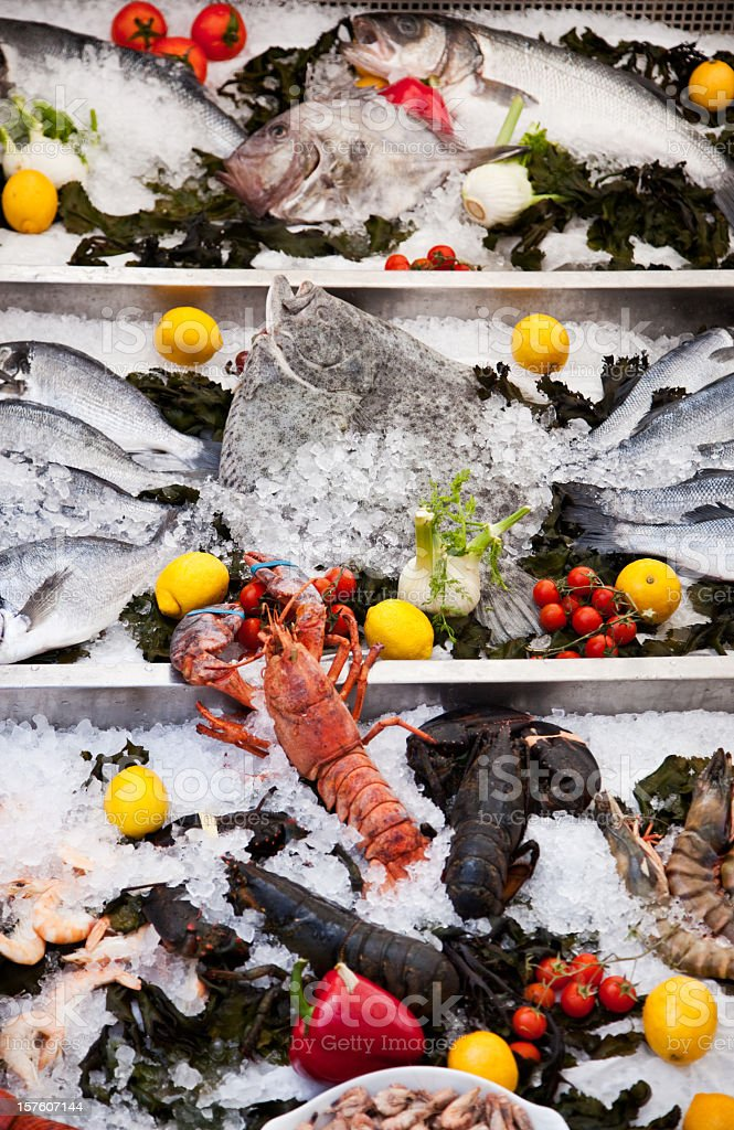 Arrangement of fresh fish and seafood at french restaurant. stock photo