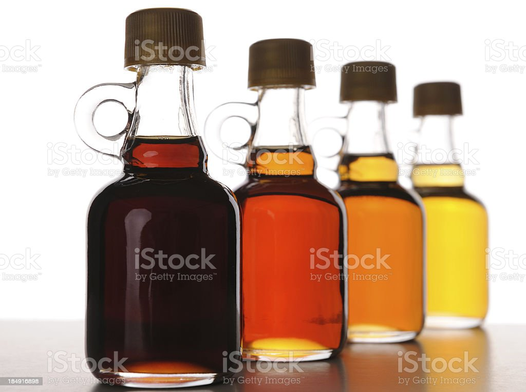 Arrangement of Maple Syrup Bottles with Various Grades stock photo